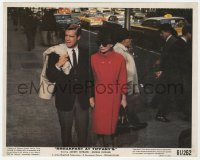 6h051 BREAKFAST AT TIFFANY'S color 8x10 still 1961 Audrey Hepburn & Peppard holding hands on street!