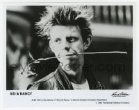 6h822 SID & NANCY candid 8x10 still 1986 great close up of director Alex Cox with rose in his mouth!