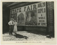 6h852 STATE FAIR 8x10 still 1933 Will Rogers & Janet Gaynor stanidng by enormous poster!