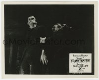 6h035 FRANKENSTEIN English FOH LC R1957 close up of monster Boris Karloff attacked from behind!