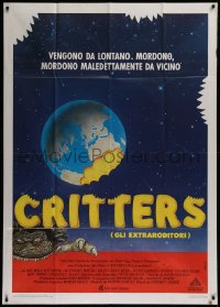 1f036 CRITTERS Italian 1p 1986 different Fuga art of monster & bite taken out of the Earth!