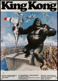 3a0087 KING KONG German 2p 1976 different John Berkey art of BIG Ape on the Twin Towers!