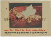 3r0033 PRINCE & THE SHOWGIRL LC #6 1957 sexiest Marilyn Monroe smiling on red couch in feathers!