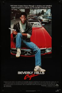4a0750 BEVERLY HILLS COP 1sh 1984 great image of detective Eddie Murphy sitting on red Mercedes!