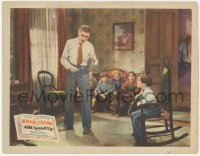 5k0894 ARROWSMITH LC 1931 Ronald Colman pulling boy's tooth as kids watch, Sinclair Lewis, John Ford
