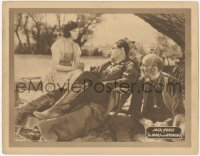 5k1232 MAN FROM WYOMING LC 1924 Lilian Rich stares at Jack Hoxie relaxing in lounge chair!
