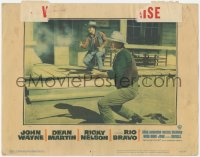 5k1363 RIO BRAVO LC #6 1959 c/u of John Wayne & Ricky Nelson in gunfight on street, Howard Hawks