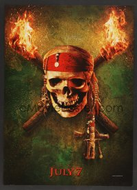 7x0016 PIRATES OF THE CARIBBEAN: DEAD MAN'S CHEST teaser jumbo WC 2006 image of skull between torches