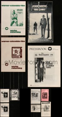 8h0012 LOT OF 11 UNCUT JOHN WAYNE AND CLINT EASTWOOD 1950S-70S PRESSBOOKS 1950s-1970s cool!