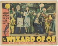 8k1297 WIZARD OF OZ LC 1939 Judy Garland with Munchkins & coroner, The Wicked Witch is dead, rare!