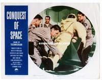 #306 CONQUEST OF SPACE lobby card #8 '55 carrying a spacesuit!!