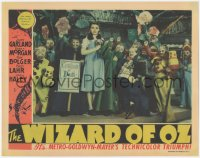 7a0481 WIZARD OF OZ LC 1939 Judy Garland with Munchkins & coroner, The Wicked Witch is dead, rare!