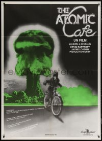 7c0021 ATOMIC CAFE Italian 1p 1984 different image of nuclear bomb explosion & guy on bike, rare!