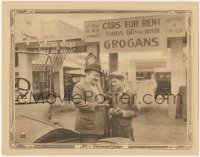 8k1185 SIXTY CENTS AN HOUR LC 1923 Walter Hiers pays man for a car rental, 60 cents per hour!