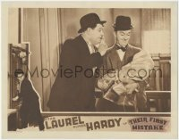 8k1223 THEIR FIRST MISTAKE LC 1932 c/u of Oliver Hardy & Stan Laurel with adopted baby, ultra rare!