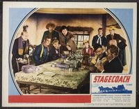 JW 152 STAGECOACH lobby card '39 John Wayne at table!